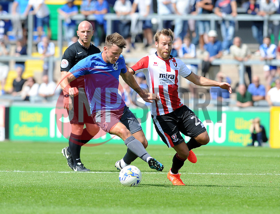 Ollie Clarke of Bristol Rovers is challenged by James Dayton of Cheltenham Town - Mandatory by-line: Neil Brookman/JMP - 31/07/2016 - FOOTBALL - Memorial Stadium - Bristol, England - Bristol Rovers v Cheltenham Town - Pre-season friendly