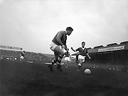 28/09/1960<br /> 09/28/1960<br /> 28 September 1960<br /> Soccer International: Ireland v Wales at Dalymount Park, Dublin. Wales won the game 3-2. Noel Dwyer the Irish keeper about to clear the ball under pressure.