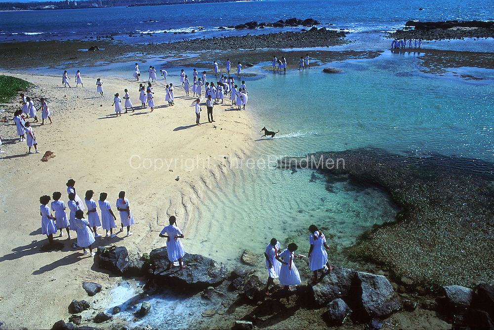 School children on a field trip. Beach below the ramparts of the Galle Fort.