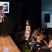 Designer Barbara Volker being acknowledged in the audience