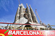 La Sagrada Familia, a major tourist attraction in Barcelona, Catalonia, Spain. A Barcelona city tour bus in front of this landmark