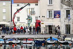 After two months of restoration, the Statue of Archangel Michael, made of copper plate, returned to Piran. The image shows The Statue of Archangel Michael on Tartini Square before helicopter placing it on top of the church's clock, on October 15, 2018 in Piran, Slovenia. Photo by Matic Klansek Velej / Sportida