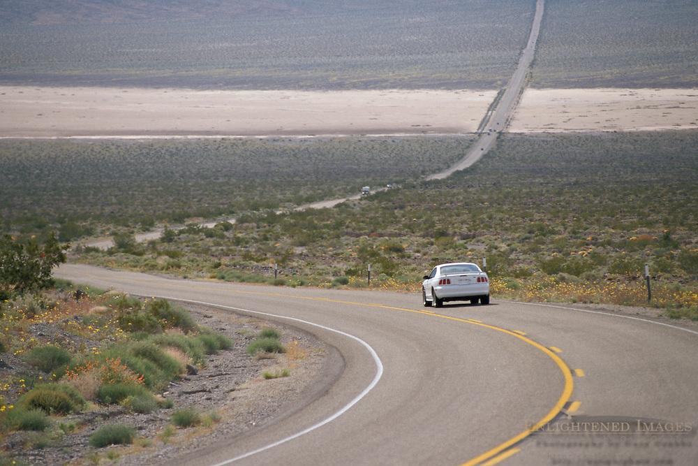 Car on asphalt desert highway 190 through Panamint Valley, Death Valley National Park, California