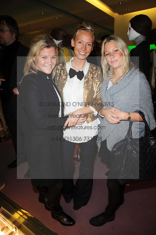 Left to right, OLIVIA PERRY, MARTHA WARD and DAVINA HARBORD at a party hosted by Prada to celebrate launch of a book documenting the company's diverse projects in fashion, architecture, film and art held at their store 16/18 Old Bond Street, London on 19th November 2009.