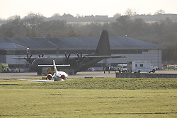 © Licensed to London News Pictures. 23/02/2016. London, UK. An RAF Heruclees lands at Northolt. An ambulance carrying nurse Pauline Cafferkey will be  police escorted from RAF Northolt.  The Scottish nurse contracted the Ebola virus in Sierra Leone in 2014 and has been admitted to the Royal Free hospital in London with the condition twice before .  Photo credit: Peter Macdiarmid/LNP