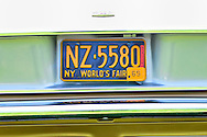 April 28, 2013 - Floral Park, New York, U.S. - This New York World's Fair 1965 license plate is on the rear of Don Pezzolla's 1964 Chevy Corvair 140, at the Antique Auto Show, where New York Antique Auto Club members exhibited their cars on the farmhouse grounds of Queens County Farm Museum.