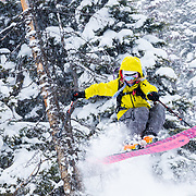 Lynsey Dyer drops a shifty air in untracked powder during a major winter storm in the Tetons.