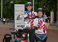 Two very happy finishers with their medals on The Mall. The Prudential RideLondon Sportives. Sunday 29th July 2018<br /> <br /> Photo: Andrew Baker for Prudential RideLondon<br /> <br /> Prudential RideLondon is the world's greatest festival of cycling, involving 100,000+ cyclists - from Olympic champions to a free family fun ride - riding in events over closed roads in London and Surrey over the weekend of 28th and 29th July 2018<br /> <br /> See www.PrudentialRideLondon.co.uk for more.<br /> <br /> For further information: media@londonmarathonevents.co.uk