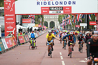 Cyclists cross the finish line on Pall Mall during The Prudential RideLondon Sportives. Sunday 29th July 2018<br /> <br /> Photo: Ian Walton for Prudential RideLondon<br /> <br /> Prudential RideLondon is the world's greatest festival of cycling, involving 100,000+ cyclists - from Olympic champions to a free family fun ride - riding in events over closed roads in London and Surrey over the weekend of 28th and 29th July 2018<br /> <br /> See www.PrudentialRideLondon.co.uk for more.<br /> <br /> For further information: media@londonmarathonevents.co.uk