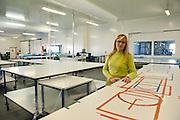 Lorette, 49 ans, dans l'usine de Sodimédical, à Plancy l'Abbaye. Elle a 15 ans d'ancienneté dans l'usine. Elle fabicait des champs opératoires. Depuis quatre mois les ouvrières de Sodimédical, à Plancy l'Abbaye (10) pointent tous les matins à 7h15 mais à la fin du mois aucun salaire ne tombe. En 2010 le groupe Lohmann & Rauscher a annoncé la fermeture de cette usine de matériel médical et le licenciement de ses 54 salariés pour délocaliser l'activité en Chine. Malgré plusieurs décisions de justice qui ont invalidé les plans sociaux , le groupe ne confie plus de travail aux ouvrières. Sans travail mais aussi sans chômage, les ouvriers sont chaque jour 8 heures à l'usine, tricotant, jouant aux cartes ou marchant en rond dans le parking, en attendant une décision.
