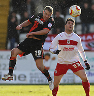 Picture by David Horn/Focus Images Ltd +44 7545 970036.16/03/2013.Dani Lopez of Stevenage is beaten to the ball by Tony McMahon of Sheffield Utd during the npower League 1 match at the Lamex Stadium, Stevenage.