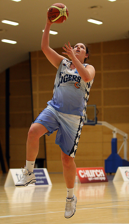 PERTH, AUSTRALIA - JULY 16: Zoe Harper of the Tigers drives to the basket during the week 18 SBL game between the Perry Lakes Hawks and the Willetton TIgers at The State Basketball Center on July 16, 2011 in Perth, Australia.  (Photo by Paul Kane/All Sports Photography)