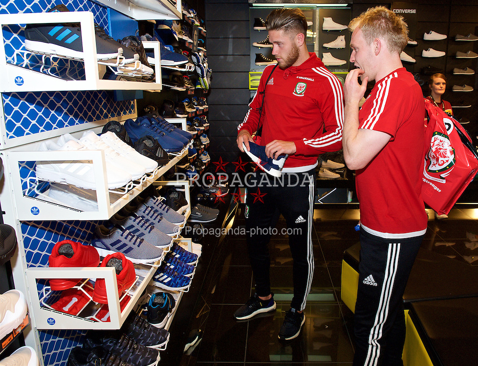 CARDIFF, WALES - Thursday, June 2, 2016: Wales' Wes Burns and Jonathan Williams looks at Adidas trainers during a visit to a JD Sports store in Llantrisant. (Pic by Ian Cook/Propaganda)