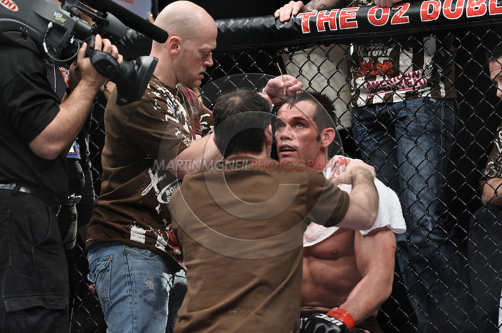 """DUBLIN, IRELAND, JANUARY 17, 2009: Rich Franklin (facing) rests in his corner between rounds during """"UFC 93: Franklin vs. Henderson"""" inside the O2 Arena in Dublin, Ireland"""