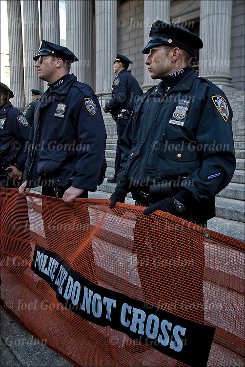 Occupy Wall Street protesters tried to stand on steps of the New York Supreme Court building in Foley Square face off with NYPD.  <br /> <br /> Police use rolled out police net to contain and then push OWS protests away from steps and sidewalk before twenty protesters were arrested.<br /> <br /> Police net used by police to control, disperse, and arrest civilians who are involved in a riot, demonstration, or protest.<br /> <br /> Law enforcement officers have long used non-lethal means to disperse crowds and detain rioters.
