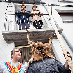 Two women watching the festival from above. Carnival of Bielsa, Huesca, Spain