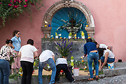 Mexican people prepare a community altar celebrating El Viernes de Dolores during Holy Week March 23, 2018 in San Miguel de Allende, Mexico. The event honors the sorrow of the Virgin Mary for the death of her son and is an annual tradition in central Mexico.