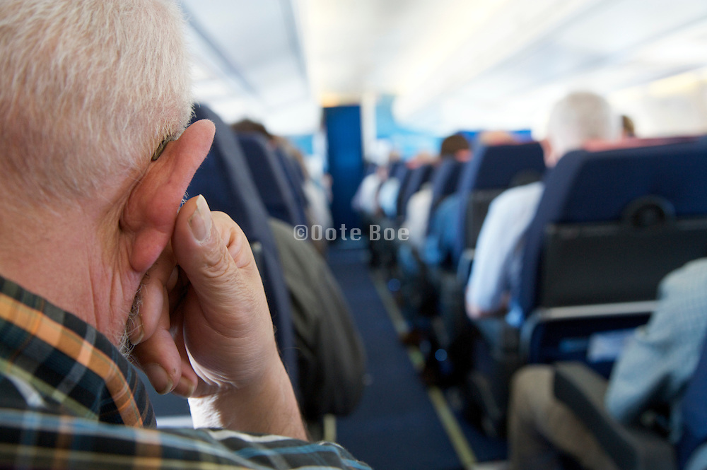 elderly man in an airplane