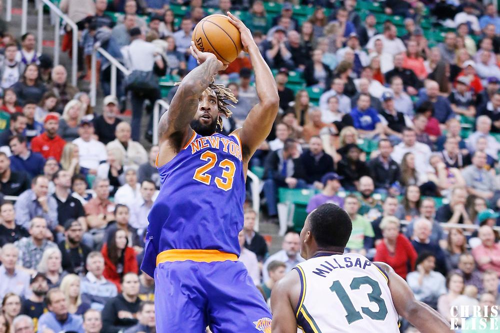 09 December 2015: New York Knicks forward Derrick Williams (23) takes a jump shot over Utah Jazz guard Elijah Millsap (13) during the Utah Jazz 106-85 victory over the New York Knicks, at the Vivint Smart Home Arena, Salt Lake City, Utah, USA.