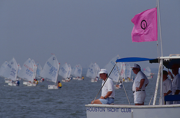 Stock photo of men standing in their boat representing the Houston Yacht Club