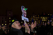 A Remain protester holds a William Rees-Mogg unicorn parody in Westminster before the result of MPs' Meaningfull Brexit vote which eventually brought about a massive defeat for Prime Minister Theresa May's Conservative government, on 15th January 2019, in Westminster, London, England.