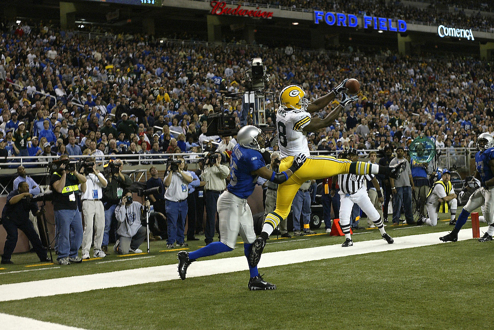 Tight end Bubba Franks (88) of the Green Bay Packers makes a catch for a touchdown as defensive back Corey Harris (25) of the Detroit Lions defends during their 22-14 defeat to the Detroit Lions on 11/27/2003. ©JC Ridley/NFL Photos.