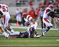 Ole Miss linebacker Mike Marry (52) makes a tackle vs. Louisiana-Lafayette in Oxford, Miss. on Saturday, November 6, 2010. Ole Miss won 43-21.