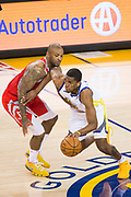 Golden State Warriors forward Kevon Looney (5) handles the ball against the Houston Rockets during Game 3 of the Western Conference Finals at Oracle Arena in Oakland, Calif., on May 20, 2018. (Stan Olszewski/Special to S.F. Examiner)