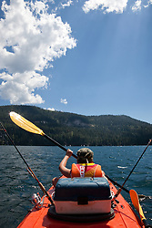 """Boy Kayak Fishing on Donner Lake"" - This young boy was photographed kayak fishing on Donner Lake, CA."