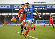 Portsmouth defender Enda Stevens holds off Leyton Orient Defender Shaun Brisley during the Sky Bet League 2 match between Portsmouth and Leyton Orient at Fratton Park, Portsmouth, England on 6 February 2016. Photo by Adam Rivers.