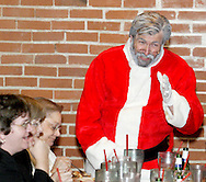 """Santa Claus (aka Jerry Francis of Dayton) during Mayhem & Mystery's production of """"I'll Be Home Shopping for Christmas"""" at the Spaghetti Warehouse in downtown Dayton, Monday, November 9, 2009."""