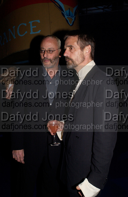 Jean Reno and Jeremy Irons, Party to celebrate 100 years of the Santos  de Cartier watch. Le Bourget airport. Paris. 7 April 2004. ONE TIME USE ONLY - DO NOT ARCHIVE  © Copyright Photograph by Dafydd Jones 66 Stockwell Park Rd. London SW9 0DA Tel 020 7733 0108 www.dafjones.com
