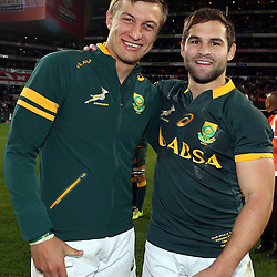 CAPE TOWN, SOUTH AFRICA - SEPTEMBER 27: Handre Pollard of South Africa with Cobus Reinach of South Africa during The Castle Rugby Championship match between South Africa and Australia at DHL Newlands on September 27, 2014 in Cape Town, South Africa. (Photo by Steve Haag)