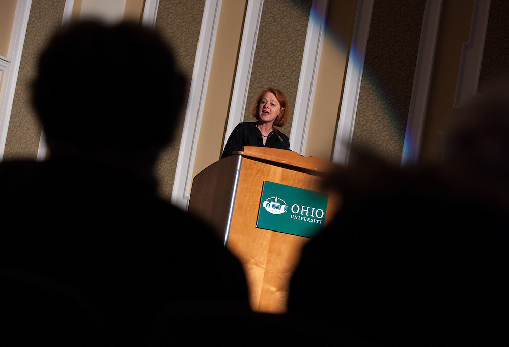 Susanne B. Dietzel, director of the Ohio University Women's Center, welcomes audience members to the Sixth annual International Women's Day Festival, held in Baker Center Ballroom on March 16, 2014. The event, sponsored in part by the Ohio University Women's Center, educated audiences about women's progress, celebrated women's achievements, and included numerous performances by female members of the Athens and Ohio University community. International Women's Day itself fell on March 8, 2014. Photo by Lauren Pond