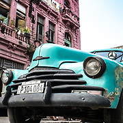 Nothing like seeing a beautiful vintage car and looking up at a pink building.<br />