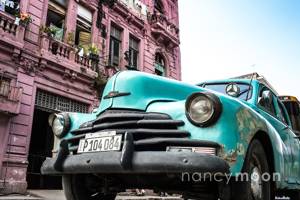 A vintage car in Havana, Cuba against the backdrop of a pink ...