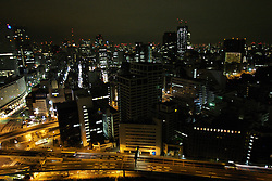 Japan, Tokyo. Early in the morning, Tokyo's highways are empty even though lights still fill the skyline. Credit as: © Josh Anon / Jaynes Gallery / DanitaDelimont.com