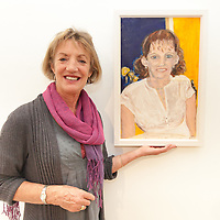 Ann O'Donoghue showing her Oil on canvas portriat of her sister Marie