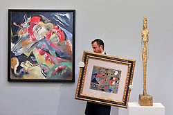"© Licensed to London News Pictures. 15/06/2017. London, UK. (L to R) ""Bild mit weissen Linien"", 1913, by Wassily Kandinsky (estimate on request), ""Femme et oiseaux"", 1940, by Joan Miró (estimate on request) and ""Grande figure"", 1947, by Alberto Giacometti (estimate GBP15-25m).  Preview of Impressionist and Modern art sale, which will take place at Sotheby's New Bond Street on 21 June.  Photo credit : Stephen Chung/LNP"