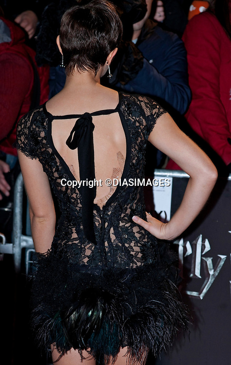 "EMMA WATSON_Fashion Faux Pas.She Uses Tit tape on her back to hold dress in place.HARRY POTTER AND THE DEATHLY HALLOWS PART 1 _ .Stars from the seventh film in the series gathered for the World Premiere at .the Odeon Leicester Square, London_England_11/10/2010.Mandatory Photo Credit: ©Dias/DIASIMAGES..**ALL FEES PAYABLE TO: ""NEWSPIX INTERNATIONAL""**..PHOTO CREDIT MANDATORY!!: DIASIMAGES(Failure to credit will incur a surcharge of 100% of reproduction fees)..IMMEDIATE CONFIRMATION OF USAGE REQUIRED:.DiasImages, 31a Chinnery Hill, Bishop's Stortford, ENGLAND CM23 3PS.Tel:+441279 324672  ; Fax: +441279656877.Mobile:  0777568 1153.e-mail: info@diasimages.com"