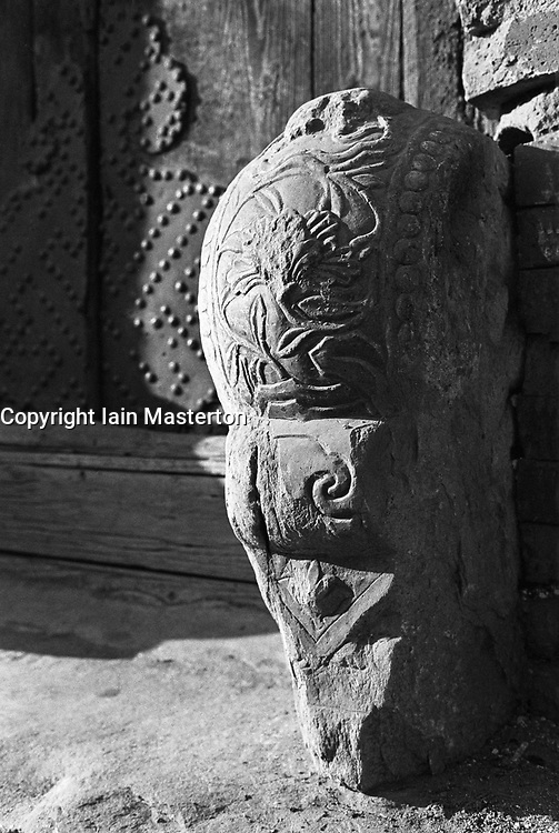 Detail of ornate carved stone outside house in hutong in Beijing