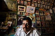 Mr. K. Moorthy seated at his desk in his studio in Nagore.