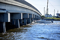 Recreational boaters head under the Highway 24 bridge as they motor past Swansboro along the White Oak River.