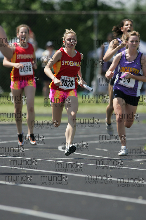 Hamilton, Ontario ---06/06/08--- Katie Glass of Sydenham in Sydenham competes in the 4X100 meter relay at the 2008 OFSAA Track and Field meet in Hamilton, Ontario..SEAN BURGES