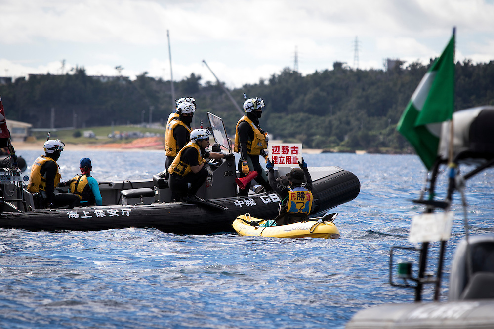 OKINAWA, JAPAN - JANUARY 19 : Japan Coast Guard try to maintain peace during the Anti-US base protest relocation at the new U.S Marine Airbase construction in Oura Bay, Camp Schwab, Henoko, Nago, Okinawa Prefecture, Japan on Janaury 19, 2017. The scheduled reclamation area for new the construction totals 160 hectares and will include 2 runways. Construction of the new base will require 21 million cubic meters of soil, enough to fill the Okinawa Prefectural Office 70 times, 17 million tons of which will be hauled in from Kyushu and Shikoku. (Photo by Richard Atrero de Guzman/NURPhoto)