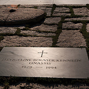 The gravesite of  First Lady Jacqueline Bouvier Kennedy wife of U.S. President John F. Kennedy, in Arlington National Cemetery, in Arlington County, Virginia. The cemetery is directly across the Potomac River and the Lincoln Memorial. U.S. war casualties, and deceased veterans, of the nation's conflicts beginning with the American Civil War, are interred in this cemetery.  <br />