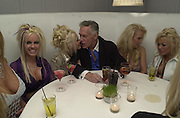 Hugh Hefner and Playboy Playmates attend Talk pre-Golden Globes party. Mondrian Hotel. West Hollywood, California USA 20 January 2001. © Copyright Photograph by Dafydd Jones 66 Stockwell Park Rd. London SW9 0DA Tel 020 7733 0108 www.dafjones.com