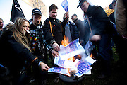 Mainz | Oct 30 2009..Dairy farmers are seen burning enlarged photocopies of 500 Euro bank notes during a protest march of german dairy farmers rallying nationwide against low prices for milk and unfair subsidy policy of the EU (European Union)...Photo: juelich/ip-photo.com