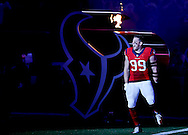 HOUSTON, TX - DECEMBER 13: J.J. Watt #99 of the Houston Texans is introduced before playing against the New England Patriots on December 13, 2015 at NRG Stadium in Houston, Texas. (Photo by Thomas B. Shea/Getty Images) *** Local Caption *** J.J. Watt