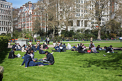 © Licensed to London News Pictures. 20/04/2016. London, UK. People enjoy the warm weather in Embankment Gardens, London. The MET Office predict highs of 13 degrees celsius. Photo credit : Tom Nicholson/LNP